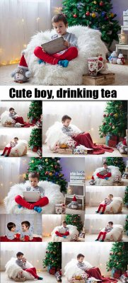 Cute boy, drinking tea and enjoying Christmas